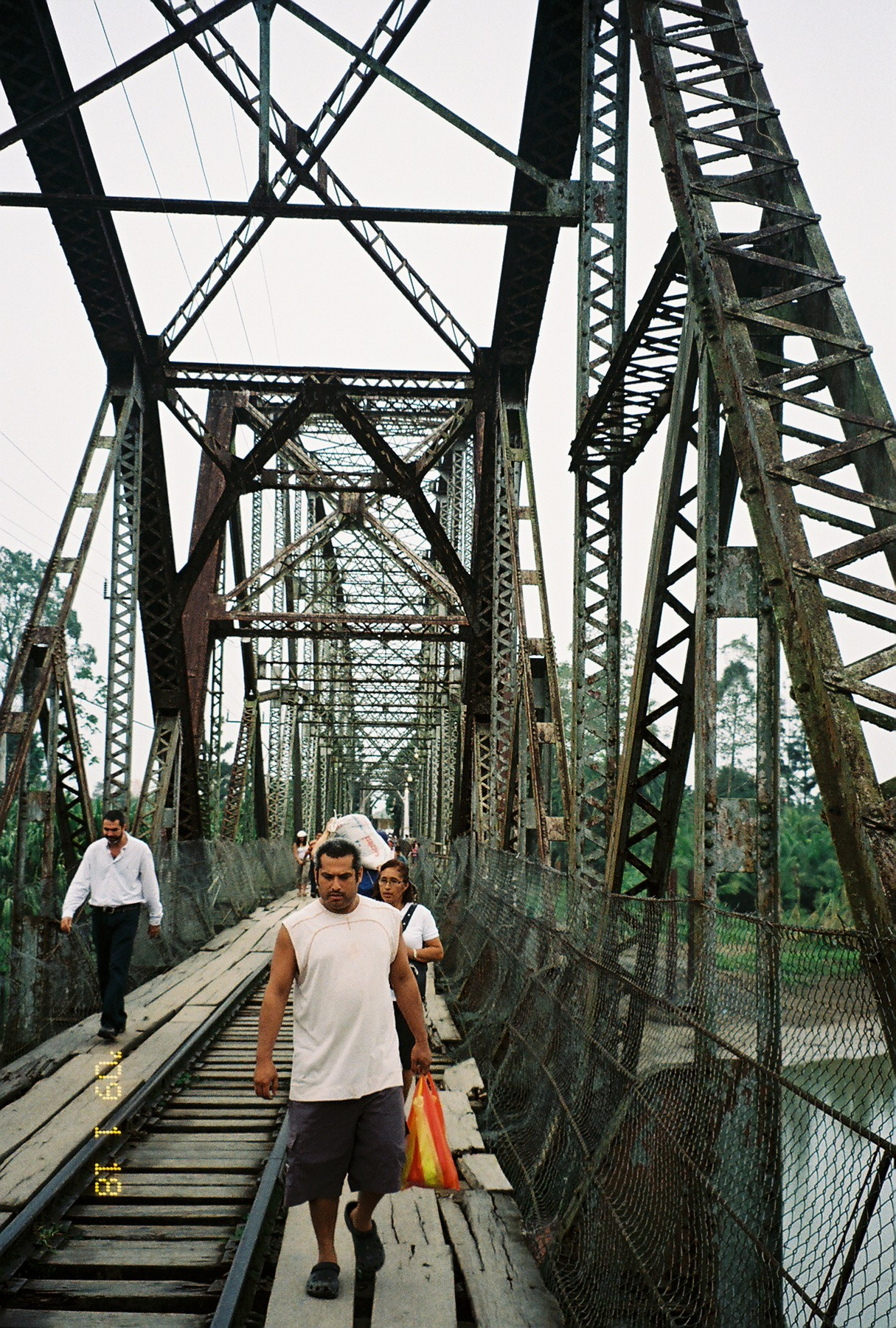People crossing the bridge from Sixaola, Costa Rica into Guabito, Panama